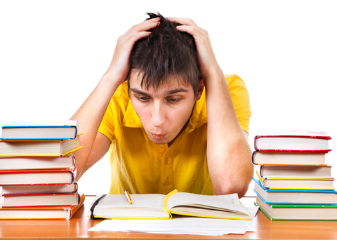 Anxious Troubled Student with Books on the Desk with a White Background