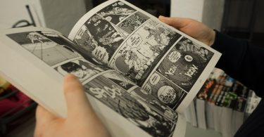 student reading comic book