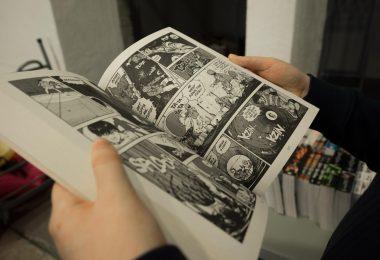 student reading comic book