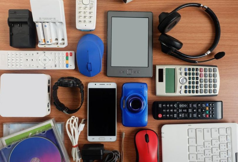 Various technology items for college sitting on a desk
