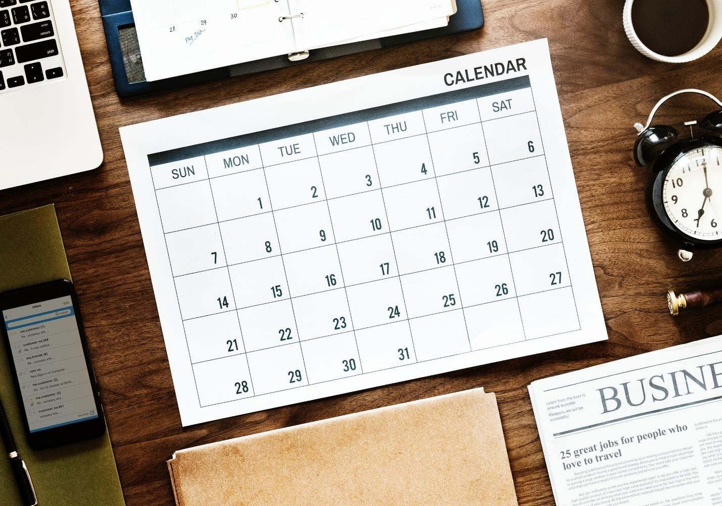 student calendar sitting on a wooden desk