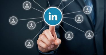 Man clicking on LinkedIn icon