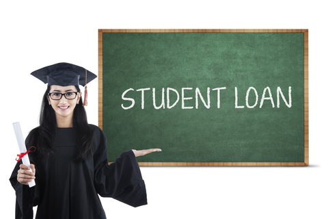 Young Asian female bachelor showing student loan text on blackboard