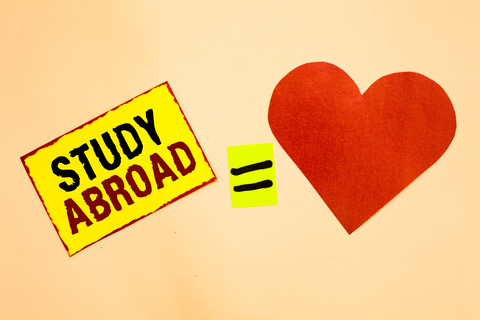 study abroad text with equals sign to red heart on a tan background