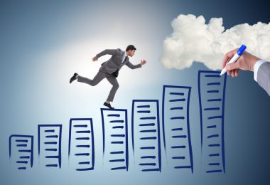 business man, climbing steps up to the clouds being drawn by a hand with a marker
