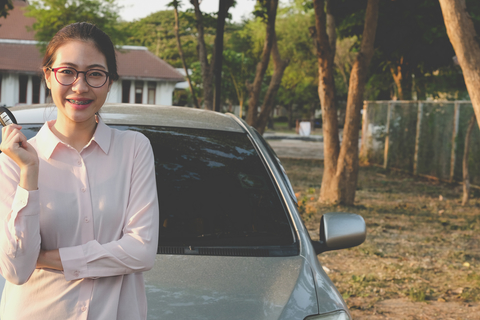 asian female college student showing car key