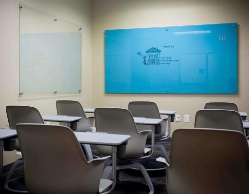 blue glass white board in empty classroom