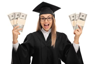 Overjoyed graduate student holding bundles of money isolated on white background