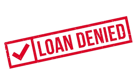 the words loan denied in red with a check mark
